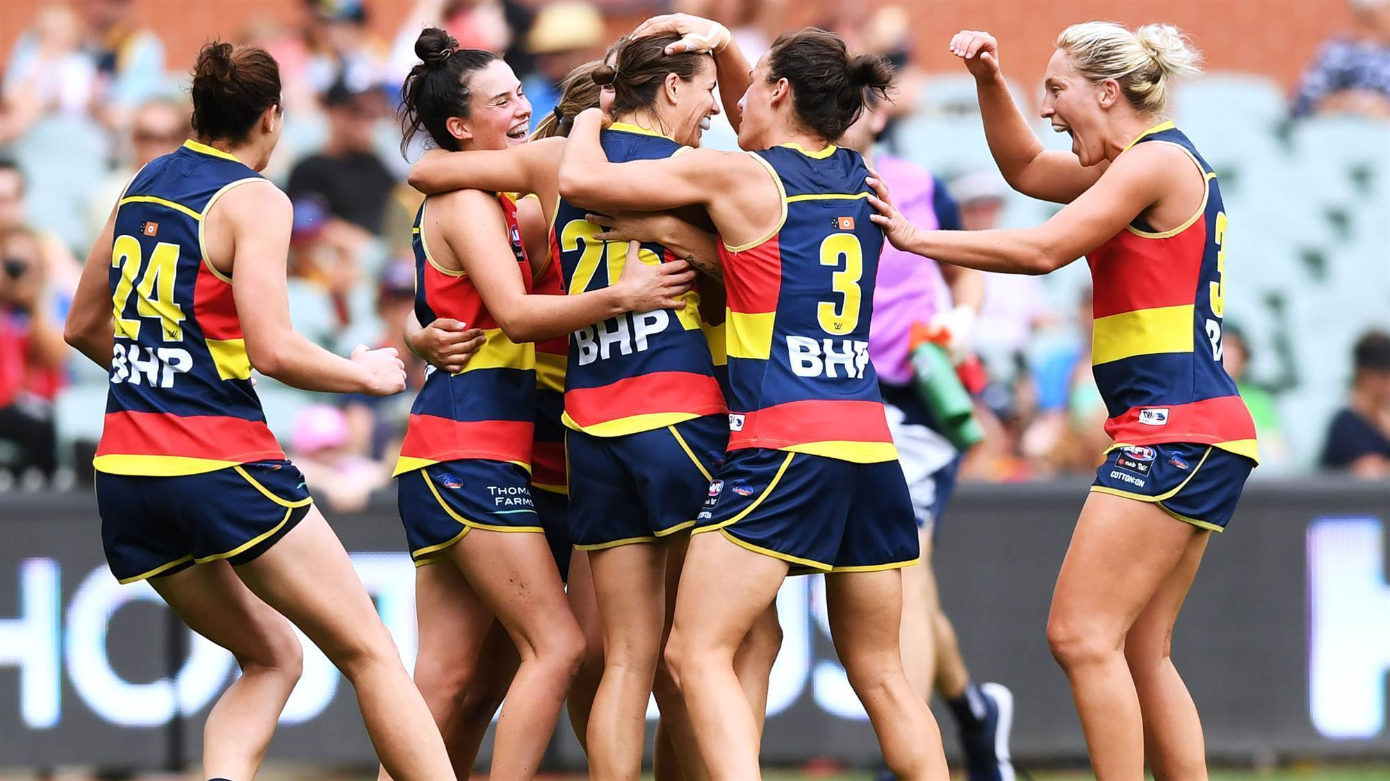 Crows win big to book home grand final