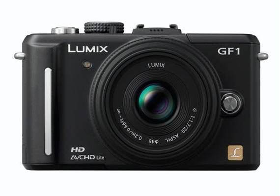 It's no DSLR, but Panasonic's Lumix DMC-GF1 has manual features and high quality images