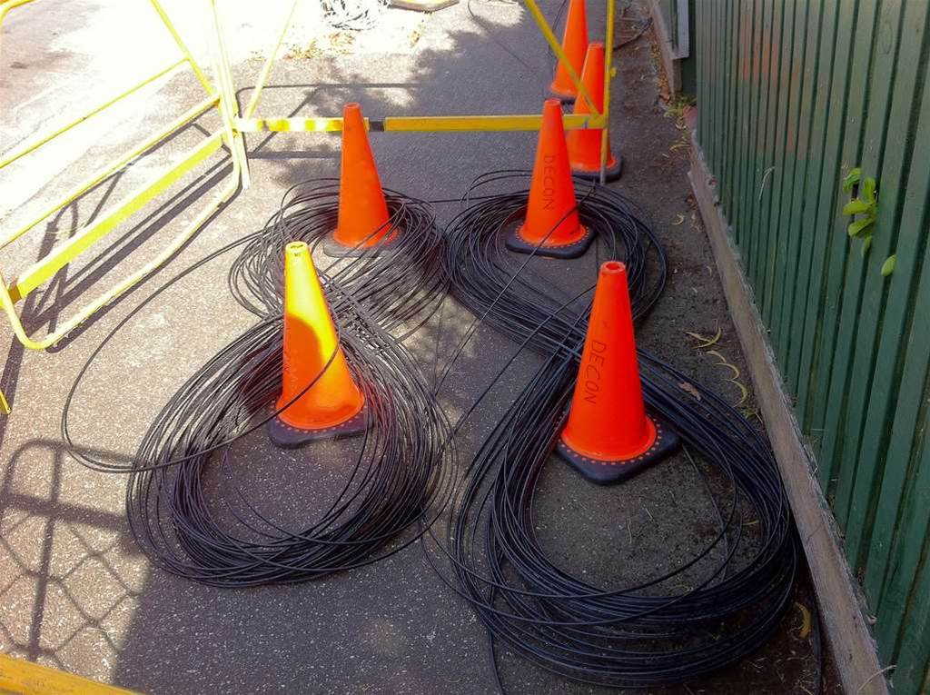 black fibre layed out in figure eights ready to be pulled in.