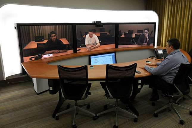 Telepresence systems can be purchased in a variety of sizes. Internode has a three-screen system in their main Adelaide office and one-screen systems in Sydney, Brisbane and Melbourne (left to right on screen).