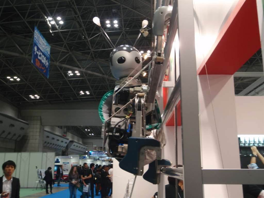 Japan's Muscle Corporation shows off Yume Robo, a monkey-like robot capable of climbing a 15m ladder. It was first shown off last year at Shanghai Expo.