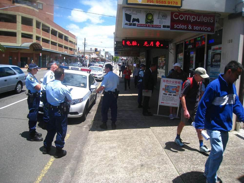 Police arrive in Hurstville for a raid on a business suspected of selling set-top boxes that access streaming pirate TV networks.