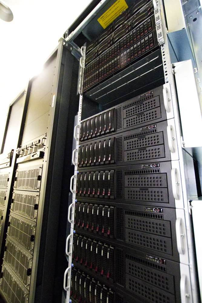 <h2>In Pictures: iVEC installs second Pawsey machine</h2>Fornax, supplied by SGI, comprises ten racks of equipment in the University of Western Australia's Physics Building. Pictured here is the Lustre file system node, comprising meta data servers in the top two shelves and object storage servers in the third and fourth shelves. The shelves below house compute nodes. (Credit: iVEC)