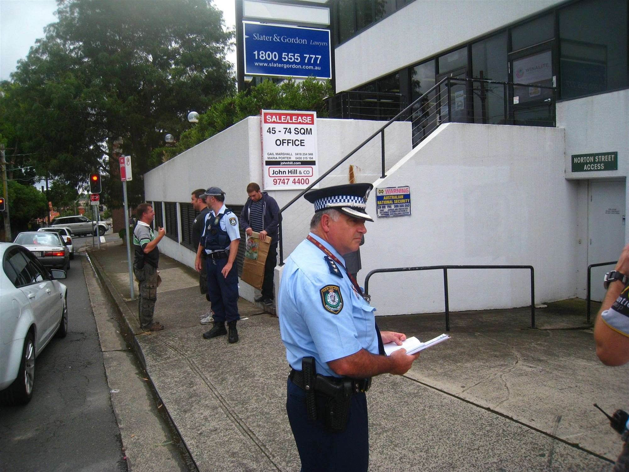 NSW Police in front of the premises.