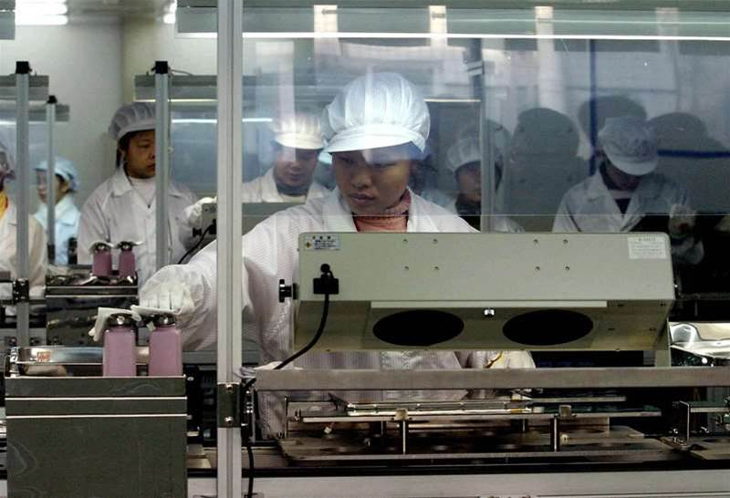 Chinese workers at one of the largest Taiwanese investment in China, the Hua Ying Guang Dian company limited's factory which produces LCDs, in Fuzhou, southeast China's Fujian province 24 January 2005. China's booming economy expanded 9.5 percent last year after 9.3 percent in 2003 in an indication tightening measures have not proved effective enough and more could be in store, as the fourth quarter alone showed growth steaming ahead at 9.5 percent year-on-year, up from 9.1 percent in the previous three months despite Beijing's efforts to cool the economy. STR/AFP/Getty Images