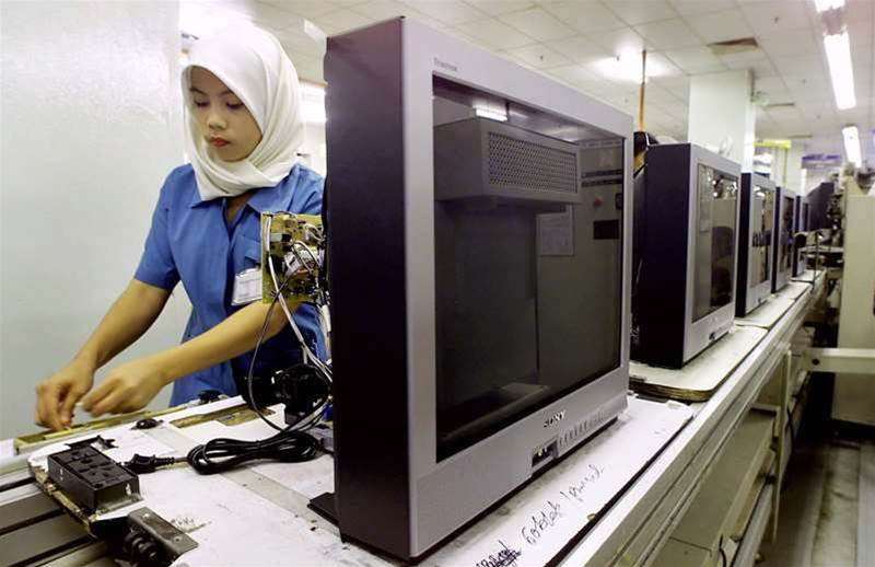 A worker prepares colour television sets on a production line at Japanese giant Sony Corp.'s Malaysian factory in Kajang, 02 October 2000. Sony announced plans to invest more than 10 million USD in its plant here in the year ending next March and said Malaysia is now its top world centre for colour TV production. JIMIN LAI/AFP/Getty Images