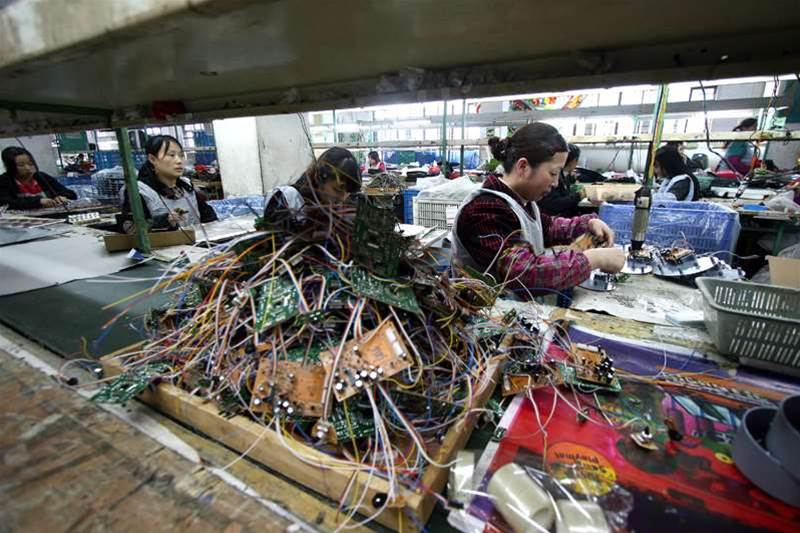 Workers make various toys and games at a factory in Jinjiang, southeast China's Fujian province on April 2, 2011. Manufacturing activity in China rebounded in March after a fall the previous month, official and independent data showed, giving Beijing more leeway to take new measures to rein in inflation. STR/AFP/Getty Images