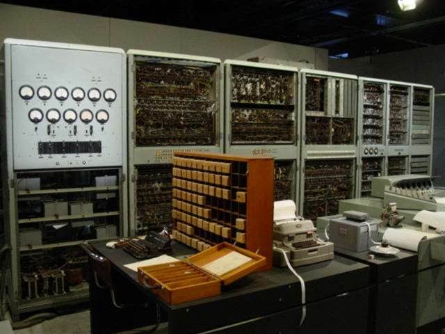 <h2>CSIRAC: Australia's first digital computer</h2>CSIRAC (an acronym for 'Commonwealth Scientific and Industrial Research Organisation Automatic Computer') was a valve-driven computer that ran its first test program in 1949, back when it was known as 'CSIR Mk1'. The main system comprised nine steel cabinets containing 2000 valves that weighed over 7000kg.<br><br>CSIRAC stored data using mercury acoustic delay lines; an early type of serial-access refreshable memory. It boasted a 1000Hz memory clock and a serial bus that transferred one bit at a time. After experiments with punch card inputs, the machine graduated to using paper tape. <br><br>Like all computers of the time, CSIRAC did not have an operating system. A programming language, called INTERPROGRAM, was eventually written for the system in 1960.   <br><br><i>[Image credit: Museum of Victoria]