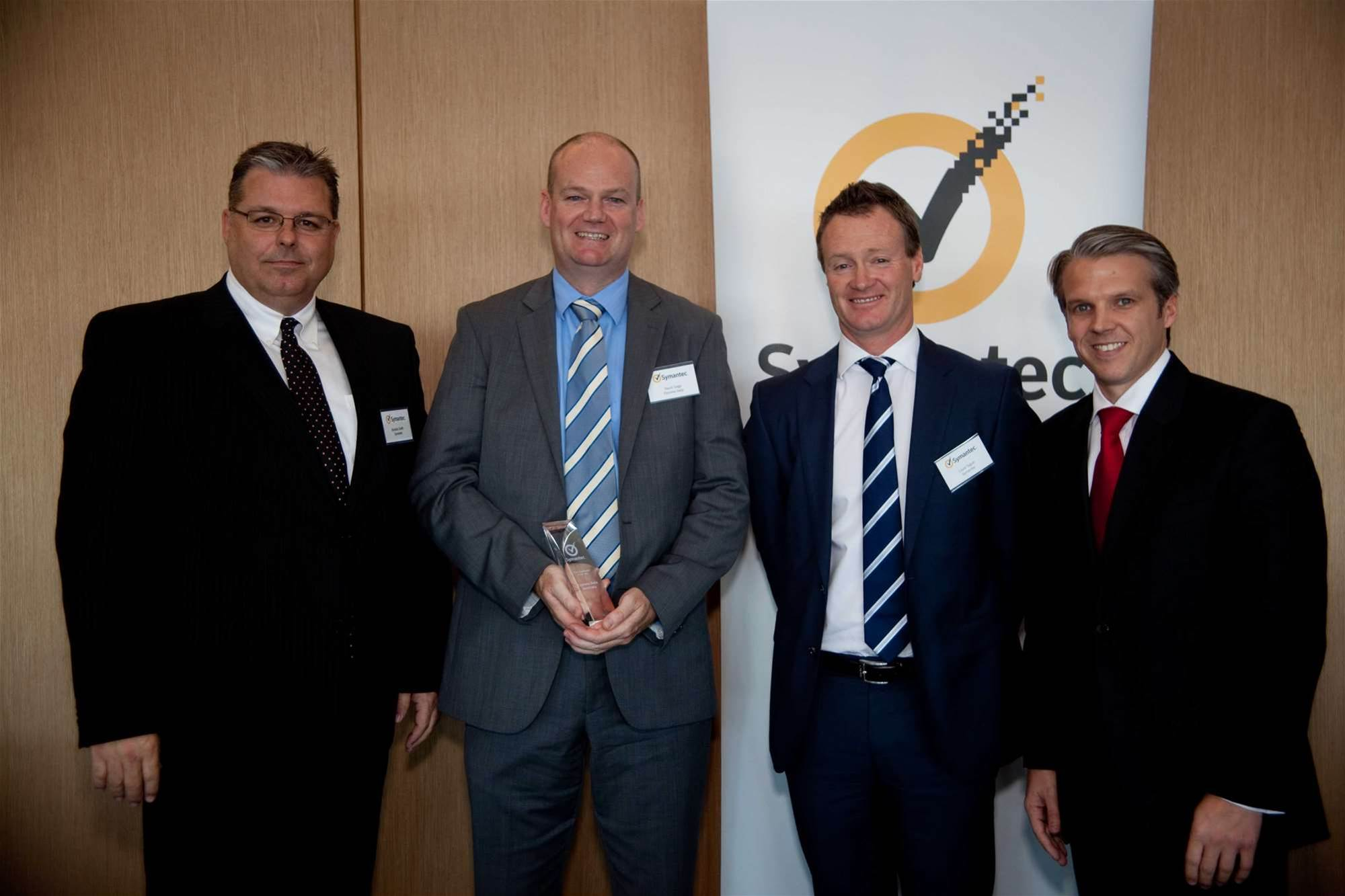 Express Data CEO David Gage (second from left)accepts his company's award for Symantec distributor of the year, presented by Symantec Pacific boss Brenton Smith (far left, channel chief Jeff Arndt (far right) and national sales manager Louis Tague.