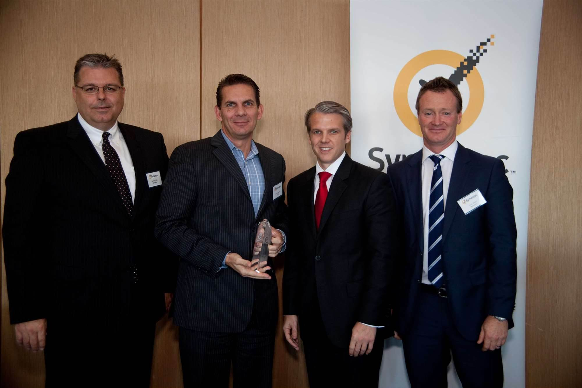 George Rodgers, national vendor manager with Data#3 (second from left) is presented with the Symantec specialised partner of the year award.
