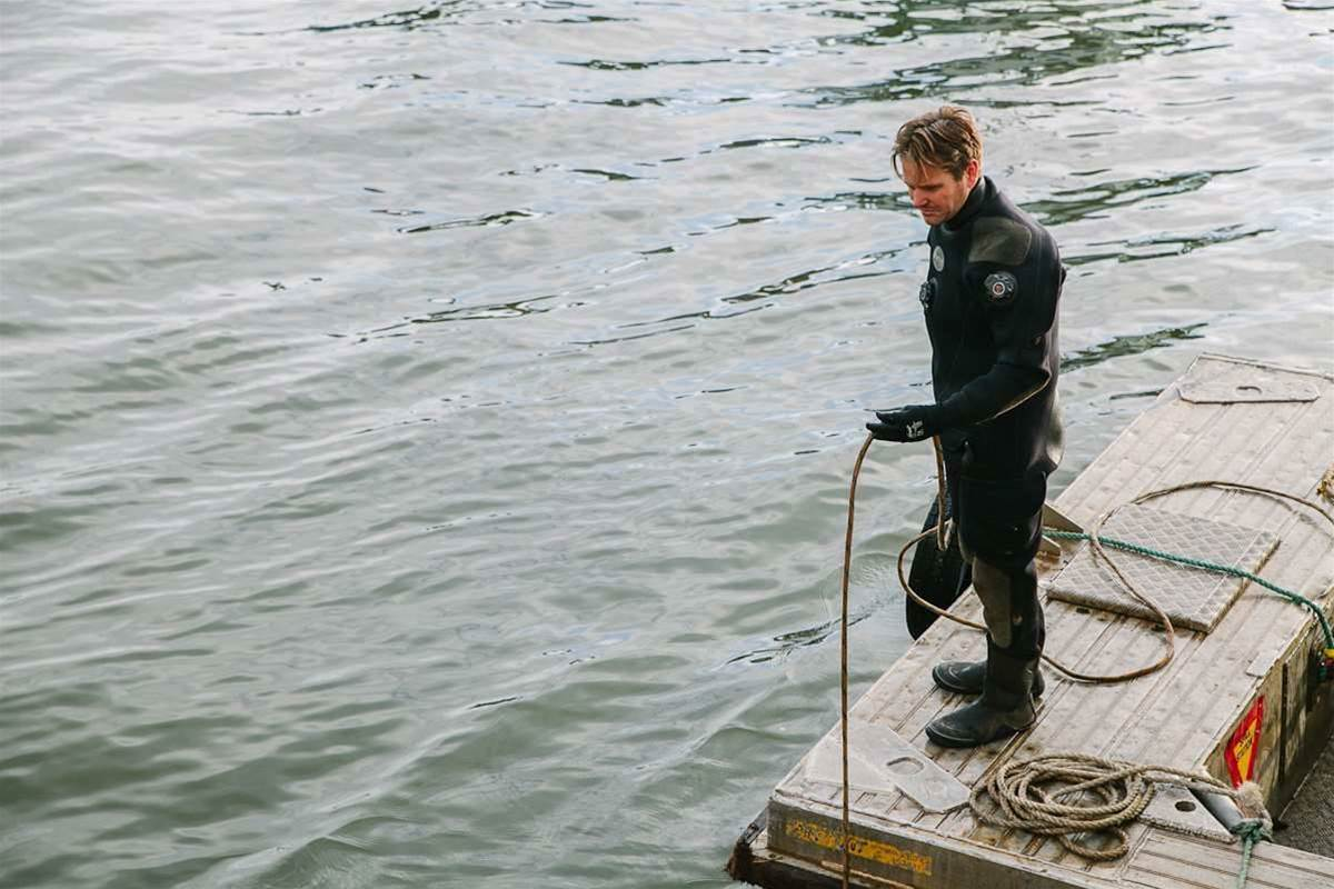 Two divers guided the fibre through the water to Blues Point.