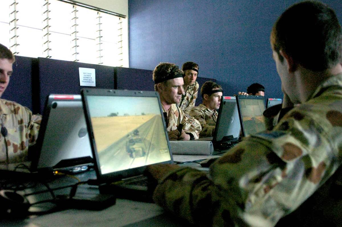 ADF soldiers using VBS2 for training in a networked classroom environment.