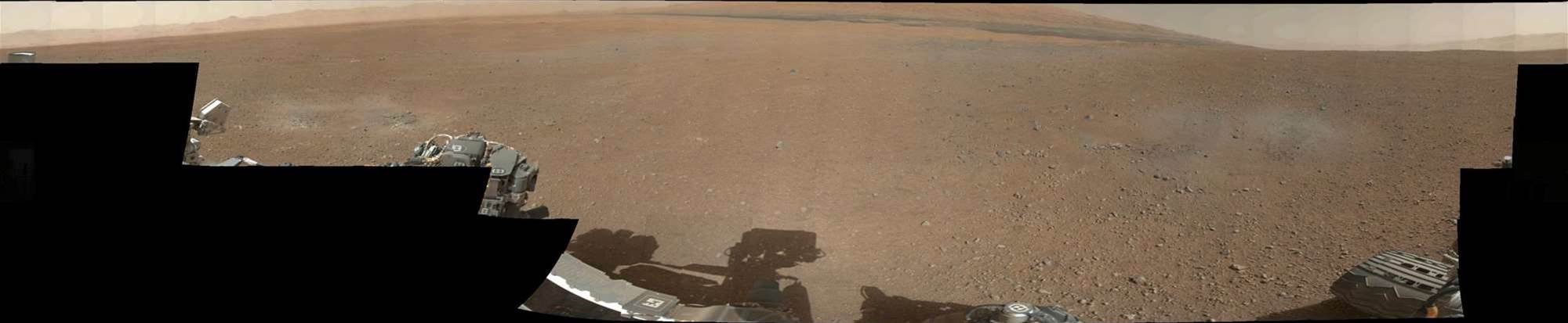 This is similar to the last shot, but in colour. The grey patched of ground are where the soil has been blown away by the rockets used to lower Curiosity to the surface, and show what NASA believes to be the Martian bedrock.  Image Credit: NASA/JPL-Caltech