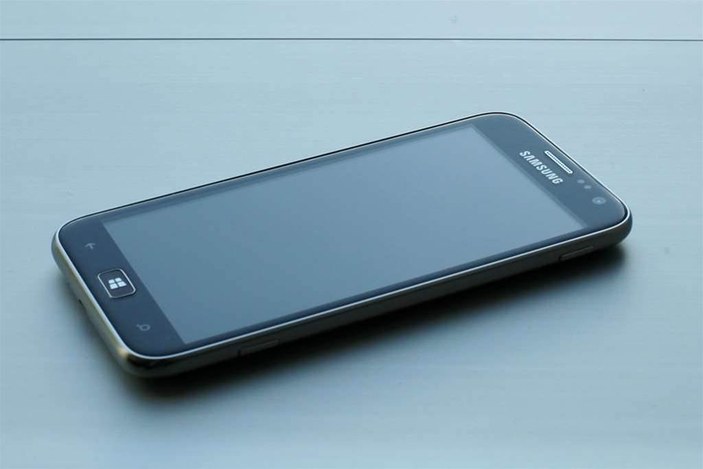 "The front of the Samsung ATIV S Windows 8 Phone. It includes a raised physical Windows button and slightly rounded edges to the 4.8"" HD Super AMOLED display. (courtesy: Windows Team Blog)"