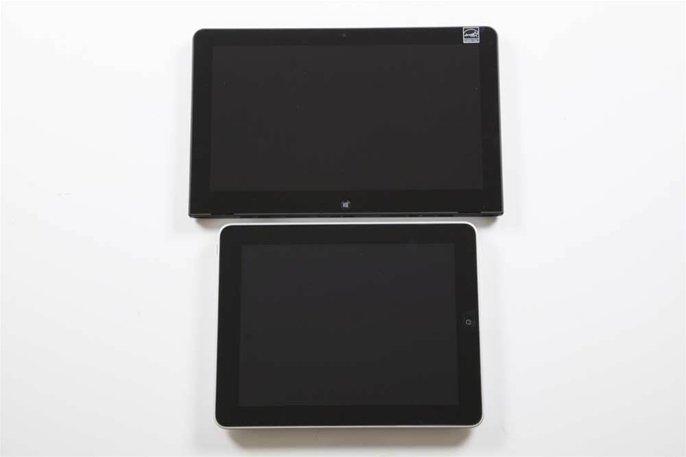 The tablet you see at the top of the photo is the Lenovo ThinkPad Helix.  As you can see, the Helix is considerably bigger than the iPad (which is not a current iPad model) in the photo below it. It's also heavier at 835g, according to the Lenovo web site.  Essentially, the Helix has the guts of a Windows laptop - a Core i5 processor - inside. And that is the idea. Slot the Helix into a special keyboard and it becomes a Windows laptop.