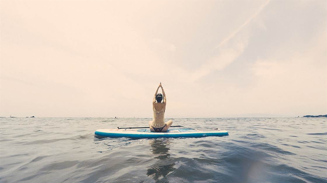 I Tried Doing Yoga On A Stand-Up Paddleboard—Here's Why You Should Too