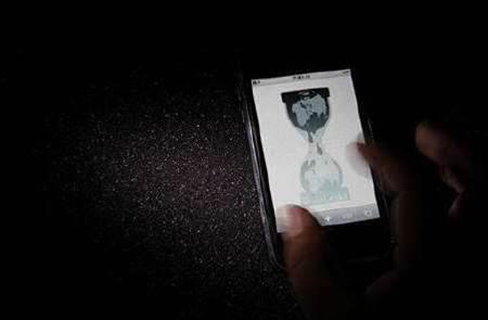 UK police arrest WikiLeaks backers for cyber attacks