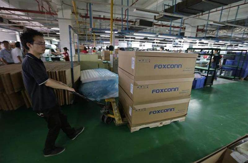 Foxconn freezes hiring at biggest plant