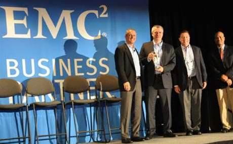 EMC shops for merger, sweats under investor pressure