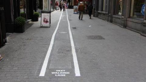 Smartphone addicts get 'text-walking' lanes in Antwerp, Belgium