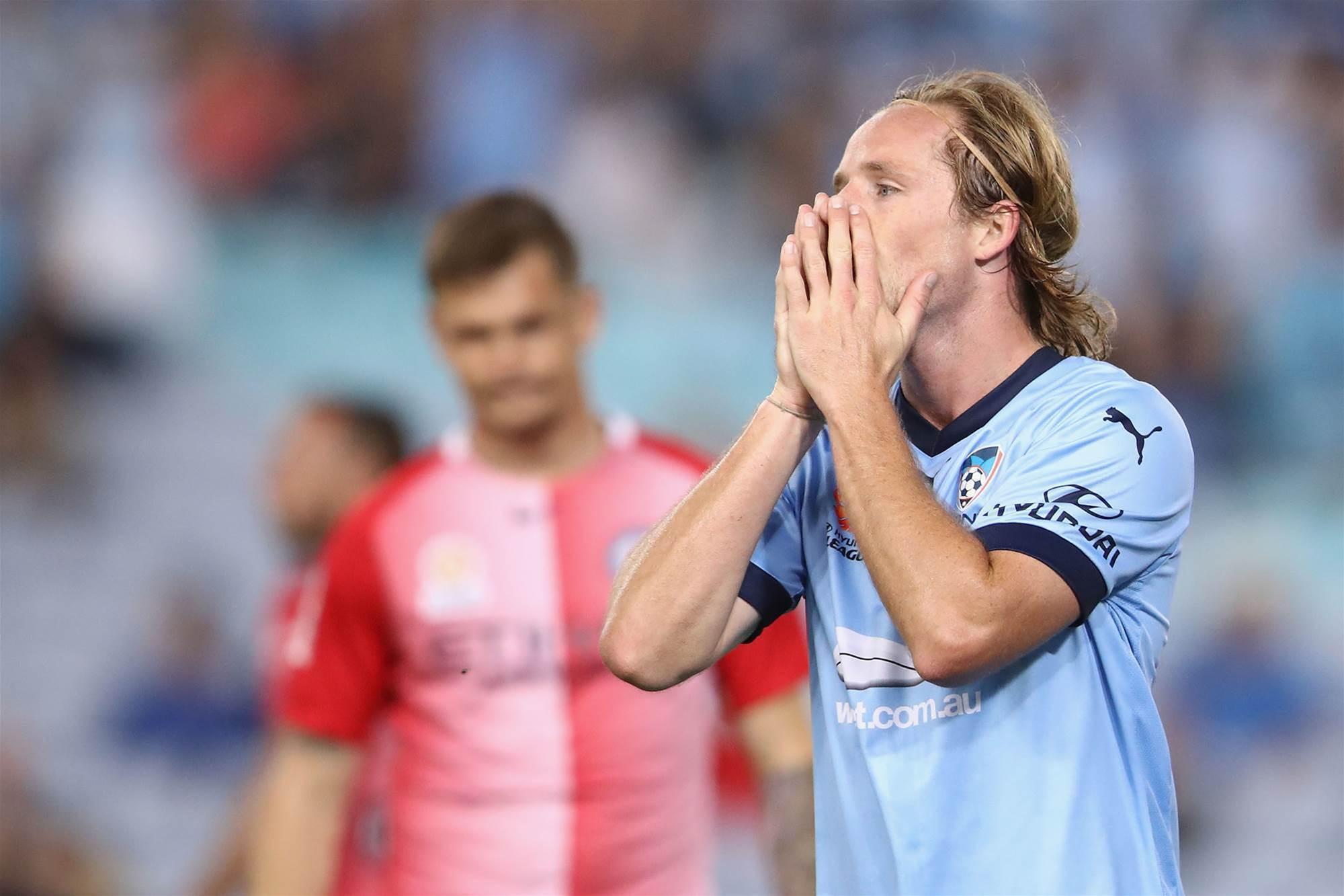Grant cools Socceroos talk