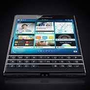 BlackBerry cuts loss, sales rise