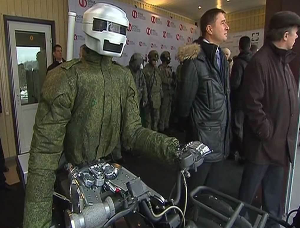 Russian Robot Warrior Drives In A Circle In Front Of Putin