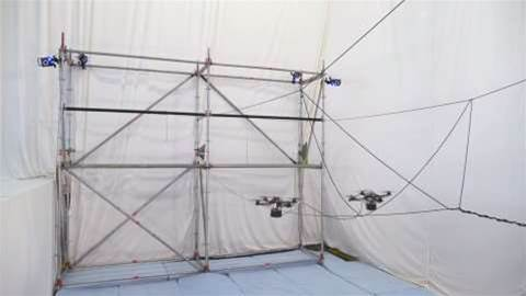 Watch drones work together to build a bridge