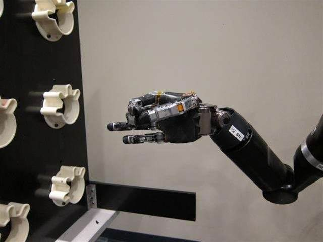 The Most Sophisticated Mind-Controlled Robot Arm Yet