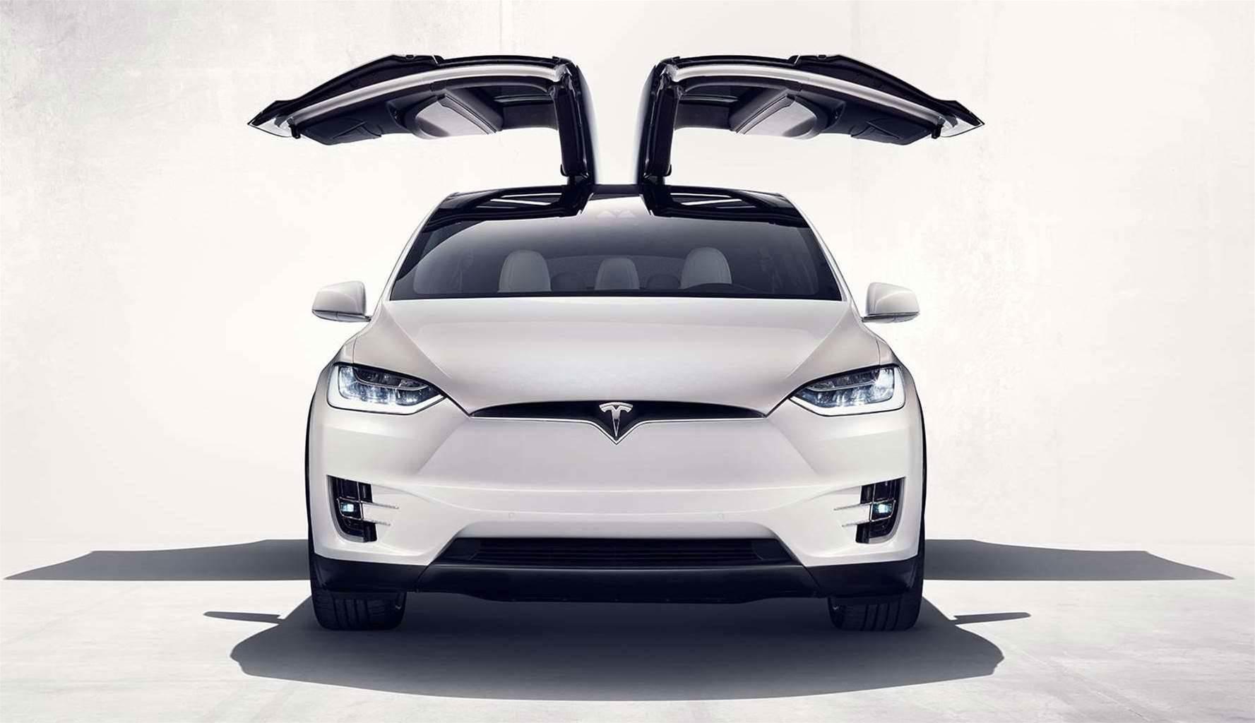 Electric SUV Showdown: Tesla vs. Audi