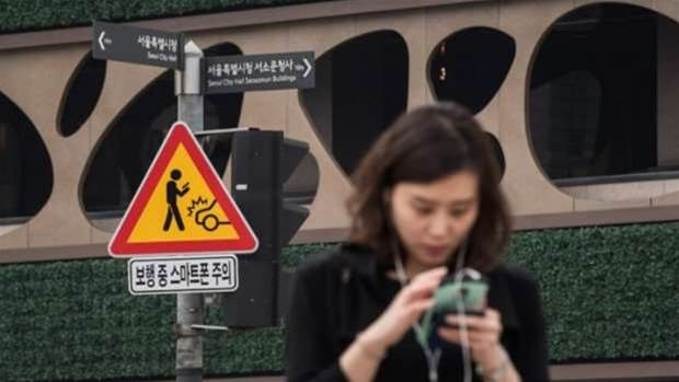 South Korea brings in road signs in a bid to reduce smartphone-related accidents