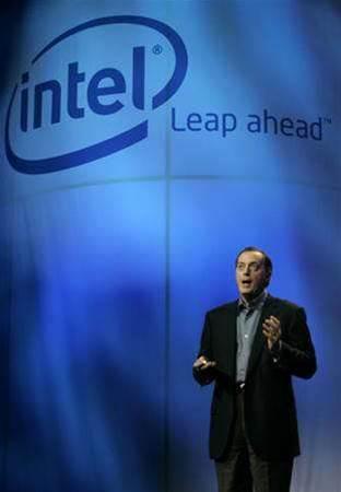 Intel cuts revenue forecast, shares fall