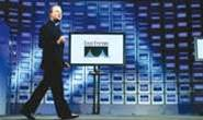 Cisco profit slides by nearly half