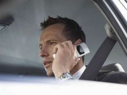 ACT cracks down on mobiles in cars
