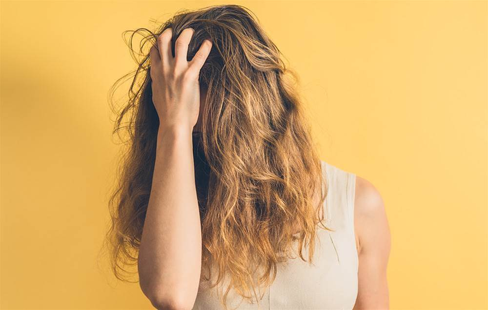 4 Surprising Ways Stress Can Ruin Your Hair