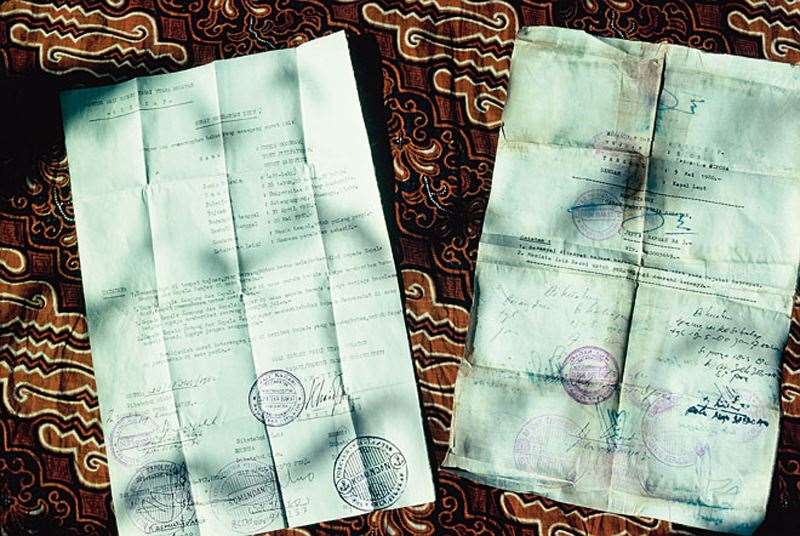 The heavily-stamped travel documents.