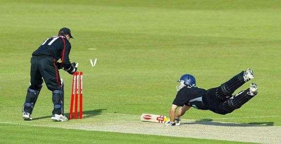 Hampshire's Simon Katich is almost caught short at the Rose Bowl in 2003.