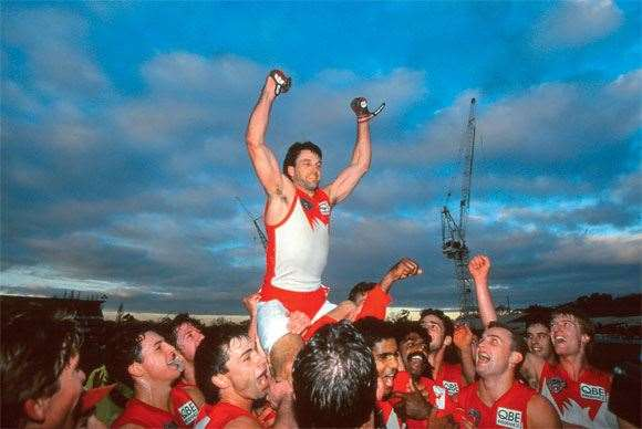 Roosy celebrates game no. 300 on Swans shoulders in 2001