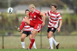 Marijana and Sarah celebrate Adelaide's opening win | Morne de Klerk/Getty Images