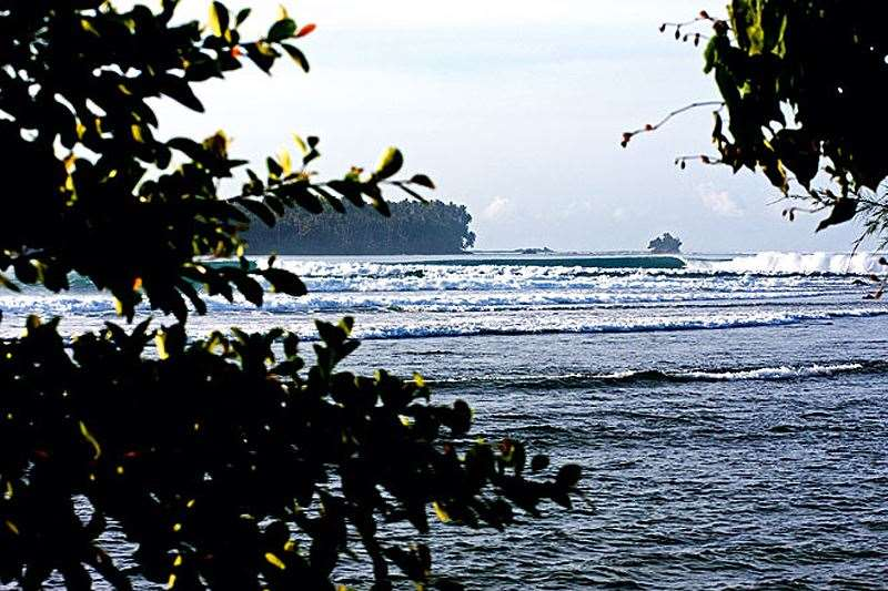 The beautiful Lagundri Bay  and one lucky soul enjoy its spoils.  Photo: Dave Sparks