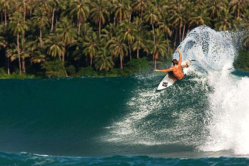 The signature deep, green water colour, long ramping wall and palm-fringed background of Nias blowing the back out of it. Photo: Dave Sparkes
