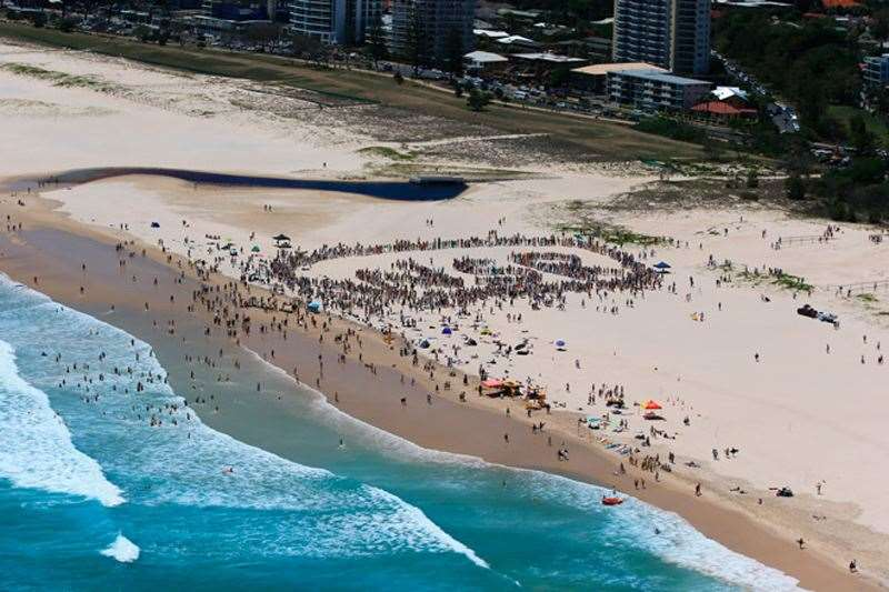 The battle now turns to listing the 38km strip from South Stradbroke to Coolangatta to be declared as a World Surfing Reserve. Marking a statement at Sunday's rally. Photo by Simon Williams
