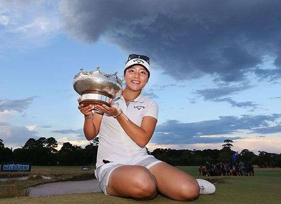 Lydia Ko celebrates victory in the Women's Australian Open with the Patricia Bridges Bowl trophy. PHOTO: Getty Images.
