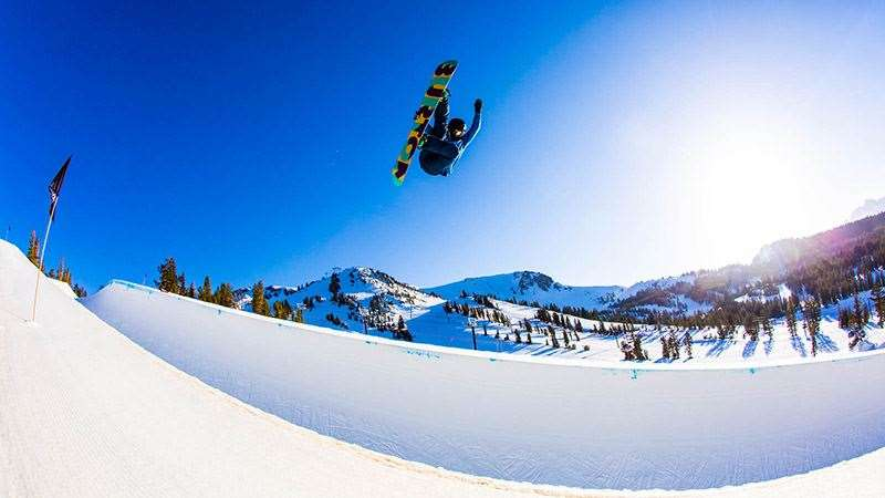 Kelly Clark with her trademark amplitude in the Mammoth Unbound Pipe