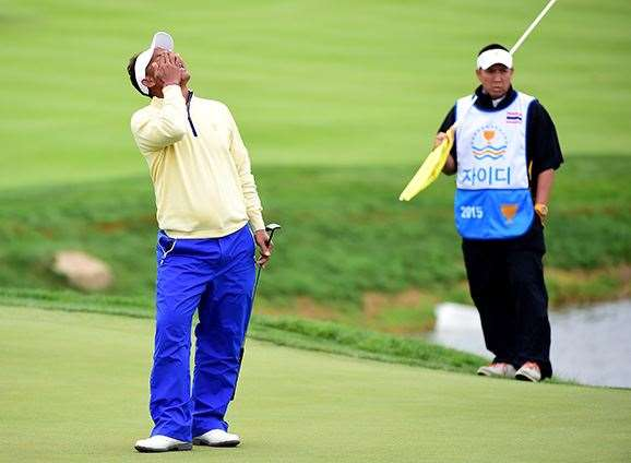 Thongchai Jaidee reacts to his missed putt on the 15th green during his match against Bubba Watson. PHOTO; Harry How/Getty Images
