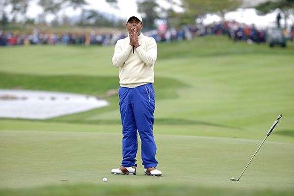 Anirban Lahiri can't believe missing a 3 foot putt on the final hole to lose his match with Chris Kirk. PHOTO: Chung Sung-Jun/Getty Images.