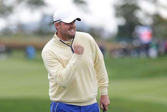 Marc Leishman punches the air after beating World No.1 Jordan Spieth. PHOTO: Chung Sung-Jun/Getty Images.