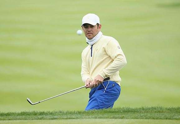 Louis Oosthuizen hits a chip during his match with Patrick Reed. PHOTO: Scott Halleran/Getty Images.