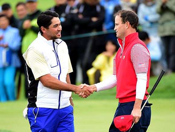 Zach Johnson shakes hands with Jason Day after a 3 & 2 win.  PHOTO: Harry How/Getty Images.