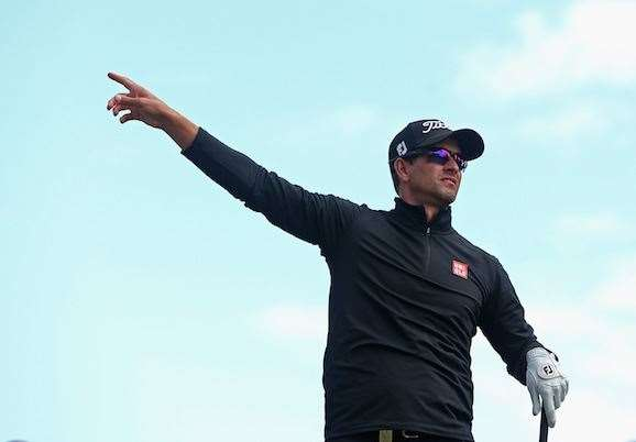 Adam Scott of Australia points to the crowd after miss hitting a wayward tee shot .  PHOTO: Quinn Rooney/Getty Images.